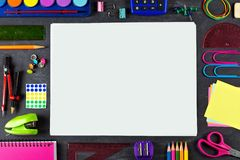 Blank white paper with school supplies frame on chalkboard Royalty Free Stock Photography