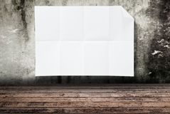 Blank white paper texture on the wood wall. Royalty Free Stock Image