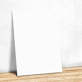 Blank white paper on the white wall and the wooden floor,Mock up Royalty Free Stock Image