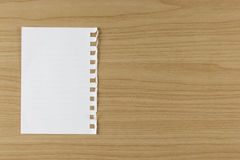 Blank white paper on wood table Stock Photos