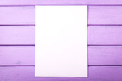 Blank white paper on wooden planks. For menu, wishes, notice, slogans royalty free stock image