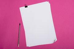 Blank white papers and pencil isolated on pink. Top view of blank white papers and pencil isolated on pink Stock Photos