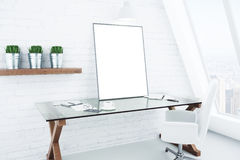 Blank white picture frame on glassy table in modern white style Royalty Free Stock Photo