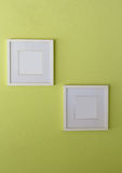 Blank white picture frame on limegreen wall Royalty Free Stock Photos