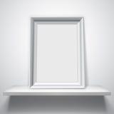 Blank White Picture Frame. On white shelf Stock Image