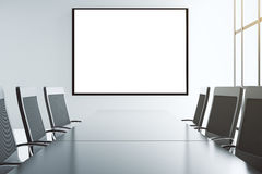 Blank white picture frame on the wall of conference room  Royalty Free Stock Photography