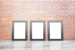Blank white picture frames in empty loft room with concrete floo Royalty Free Stock Image