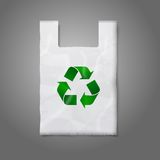 Blank white plastic bag with green recycling sign Stock Photo