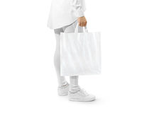 Blank white plastic bag mockup holding hand Royalty Free Stock Photo