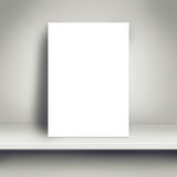 Blank White Poster Mock Up on White Shelf. Blank White Paper Poster Leaning on White Shelf in the Room as Copy Space for Design and Template Mock up for Adding royalty free stock photography