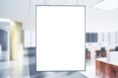 Blank white poster in the office at sunrise Royalty Free Stock Photography