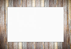 Blank white poster on vintage wooden wall background Royalty Free Stock Photo