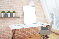 Blank white poster on white wooden table in loft room with brick Stock Images