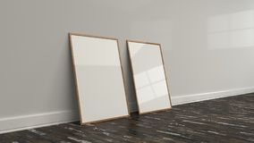 Blank white poster in wooden frame standing on the floor. Near the wall. Picture or photo mockup. 3D render illustration Royalty Free Stock Images
