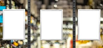 Blank white posters in aluminium frames. Glassy showcase on the street. Background for mockup royalty free stock images