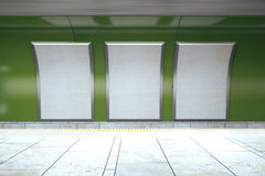 Blank white posters on green subway wall Royalty Free Stock Photos