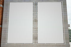 Blank white posters on grey brick wall. Mock up Royalty Free Stock Photo