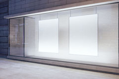 Blank white posters in the window on night empty city street, mo Royalty Free Stock Photos