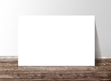 Blank white rectangle paper template banner on the wooden floor Royalty Free Stock Photos