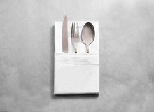 Blank white restaurant cloth napkin mockup with silver cutlery set Royalty Free Stock Photos