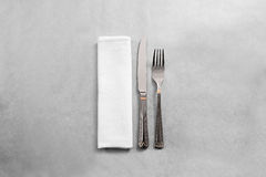 Blank white restaurant napkin mock up with fork and knife, Stock Images