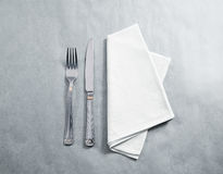 Blank white restaurant napkin mockup with knife and fork Royalty Free Stock Photo