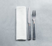 Blank white restaurant napkin mockup with knife and fork Stock Photo