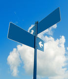 Blank white road signs in bright sky. Royalty Free Stock Photo