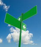 Blank white road signs in bright sky. Royalty Free Stock Photography