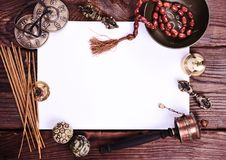 Blank white sheet and antique religious objects Stock Photography
