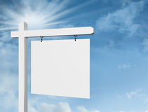 Blank white sign against deep blue sky background Royalty Free Stock Photo