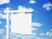 Blank white sign against deep blue sky background Stock Photo
