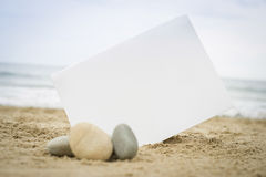 Blank white sign on the beach Stock Photography
