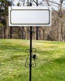 Blank white sign on railing Royalty Free Stock Photo