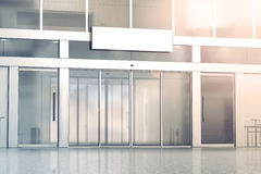 Blank white signage on the store glass doors entrance mockup Royalty Free Stock Photo