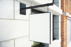 Blank white signboard on bulding wall on city street Royalty Free Stock Photography