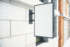 Blank white signboard on the wall outdoor Stock Photos