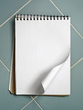 Blank white sketch book on blue Royalty Free Stock Photography