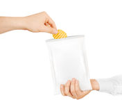Blank white snack bag mock up hold in hand isolated Stock Photography