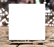Blank white square paper template banner on the road pavement Royalty Free Stock Image