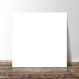Blank white square paper template banner on the wooden floor Stock Images
