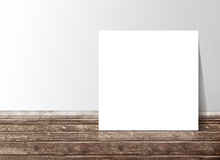 Blank white square paper template banner on the wooden floor Royalty Free Stock Photography