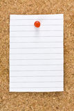 Blank White Striped Sheet Cork Board Pushpin. Vertical blank white striped sheet on cork board with a red small thumb tack Royalty Free Stock Image