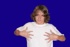 Blank White T-shirt 2. Teenage boy pointing to message space on blank white t-shirt royalty free stock photos
