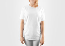 Blank white t-shirt design mockup, , clipping path. Women tshirt clear template front mock up. Empty female apparel uniform singlet model. Sweat tee shirt stock photo