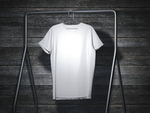 Blank white t-shirt hanging. 3d rendering. Blank white t-shirt on metal hanger. 3d rendering Royalty Free Stock Images