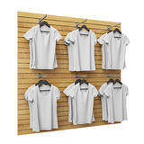 Blank white t-shirts hanging on wooden shop stand, isolated on white background Stock Photo