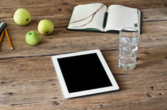 Blank white tablet computer on wooden table closeup Royalty Free Stock Photos