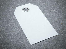 Blank white tag. On the concrete floor Royalty Free Stock Photography