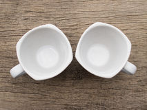 Blank white teacup on wood Stock Images